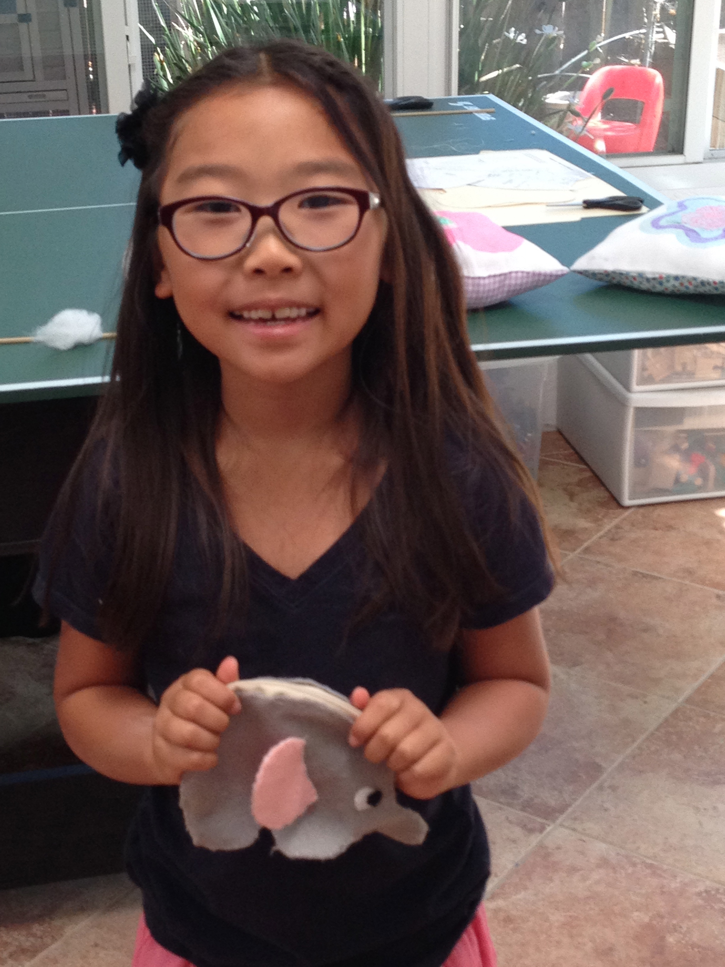 3rd grader elephant coin purse.