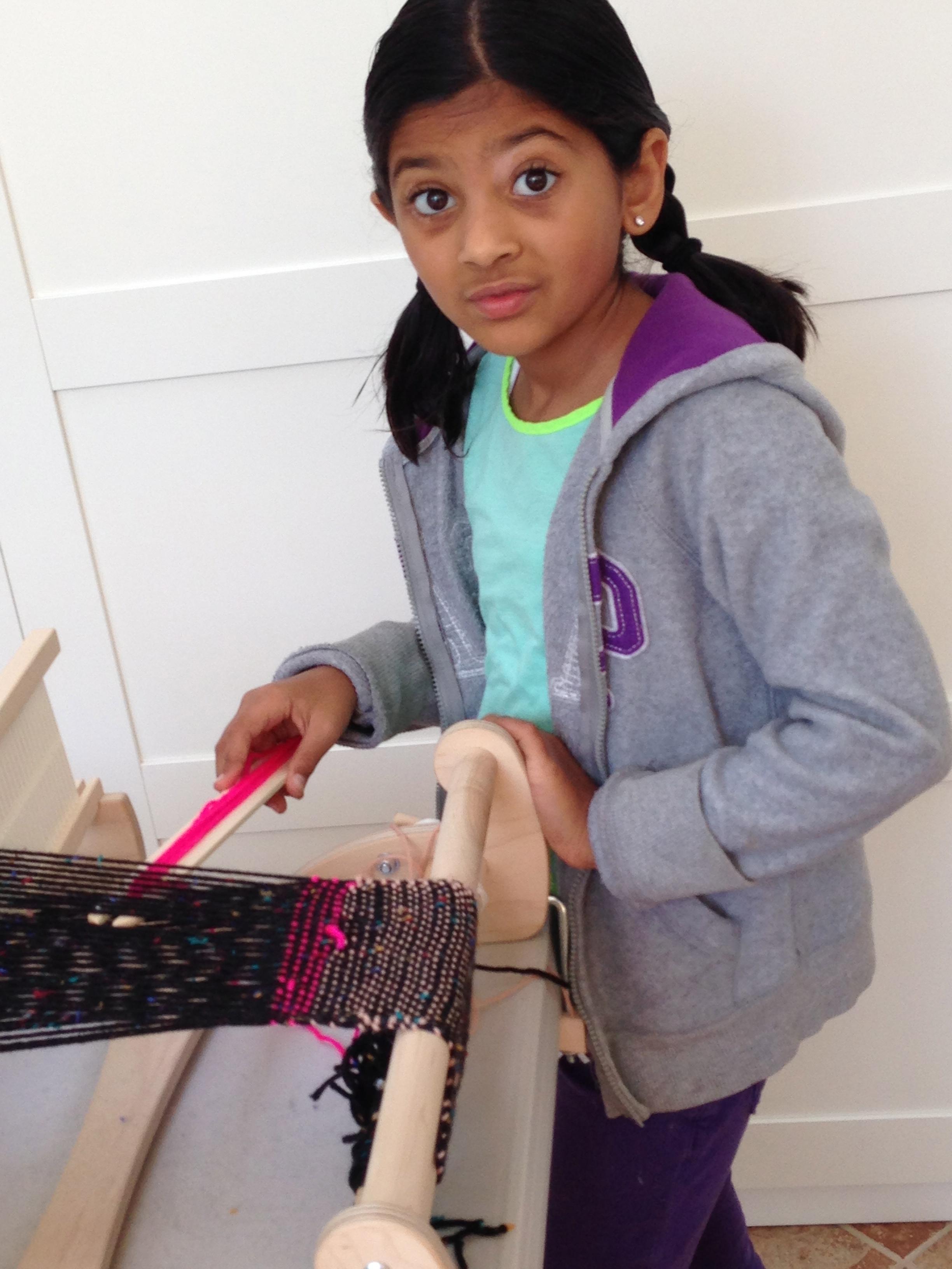 3rd grader weaving.