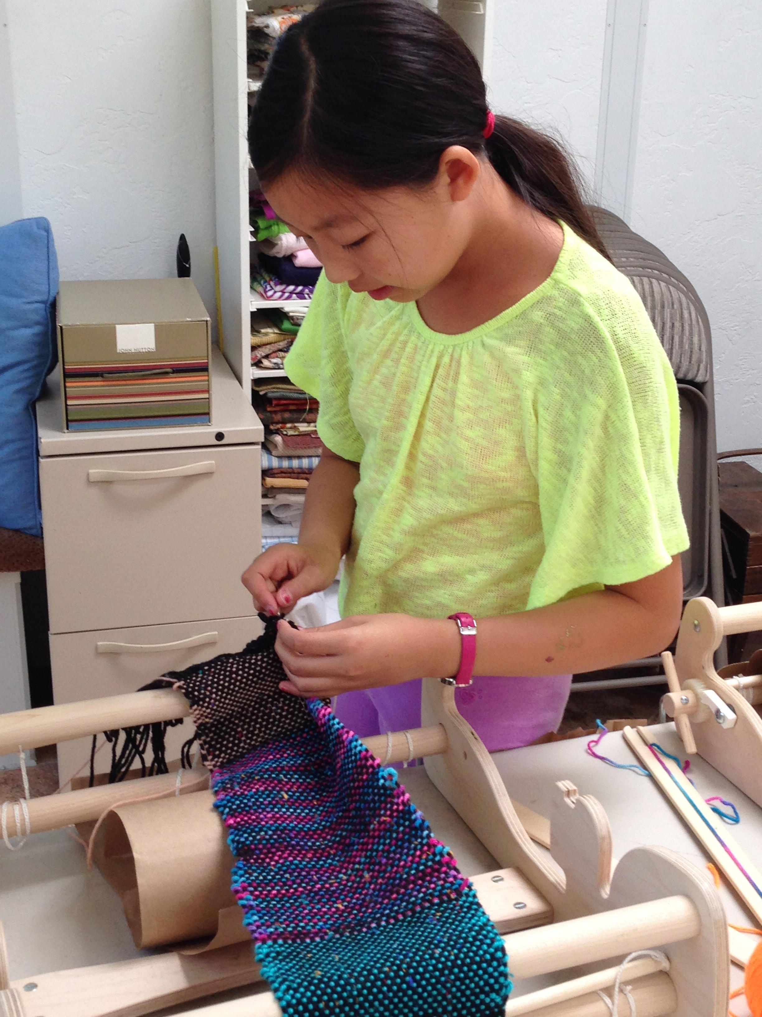 6th grader finishing her scarf.