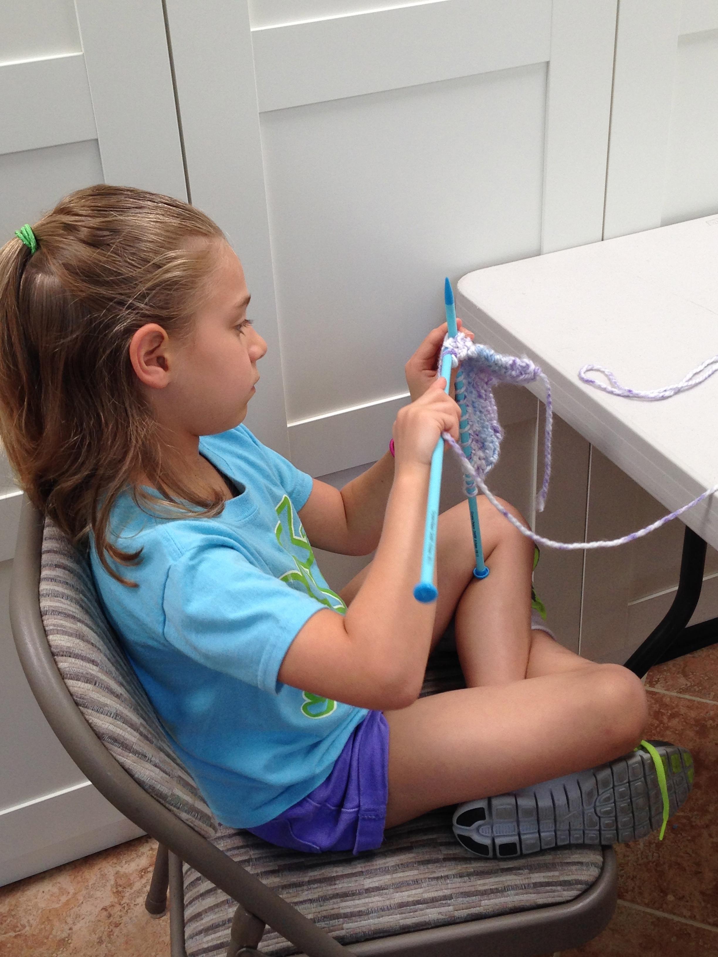 3rd grader knitting.