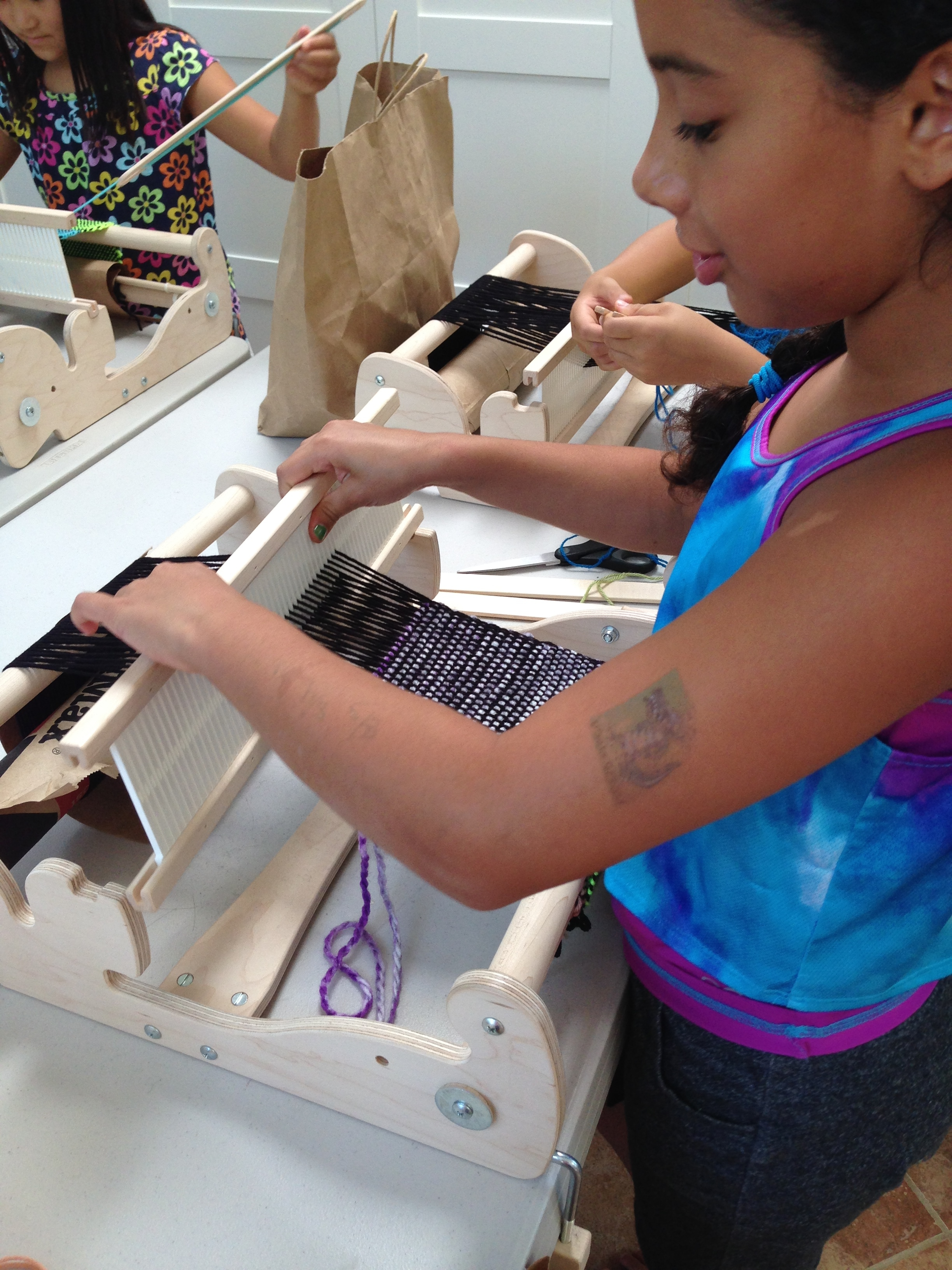 4th grader weaving.