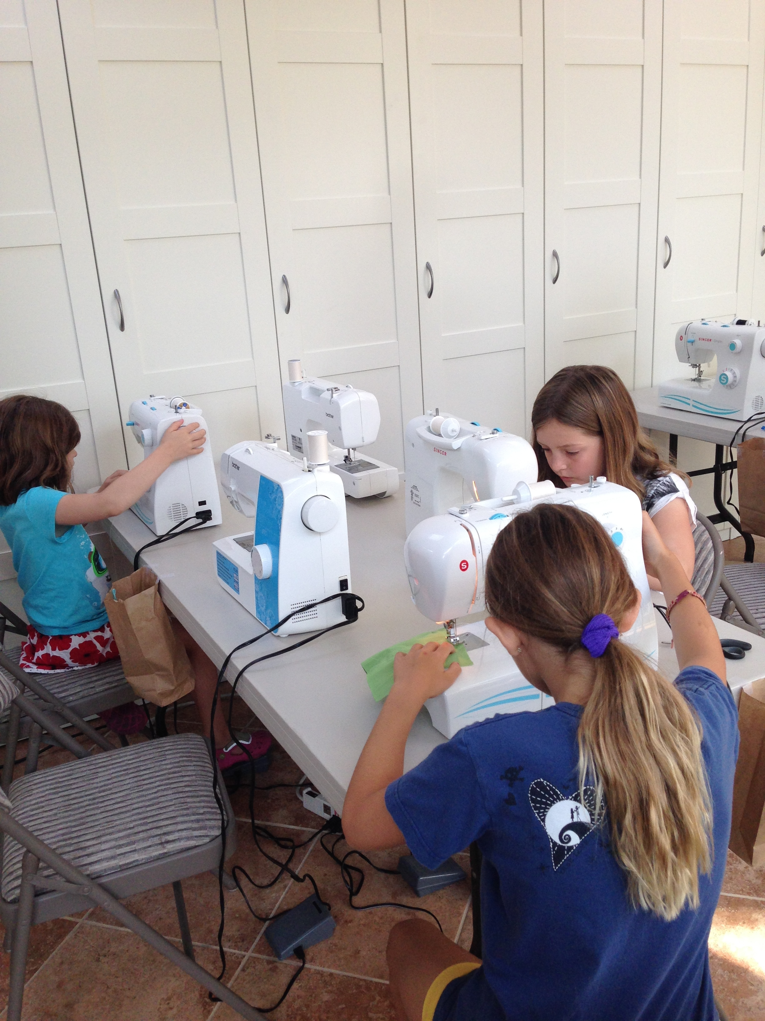 New students learning to use the sewing machines.