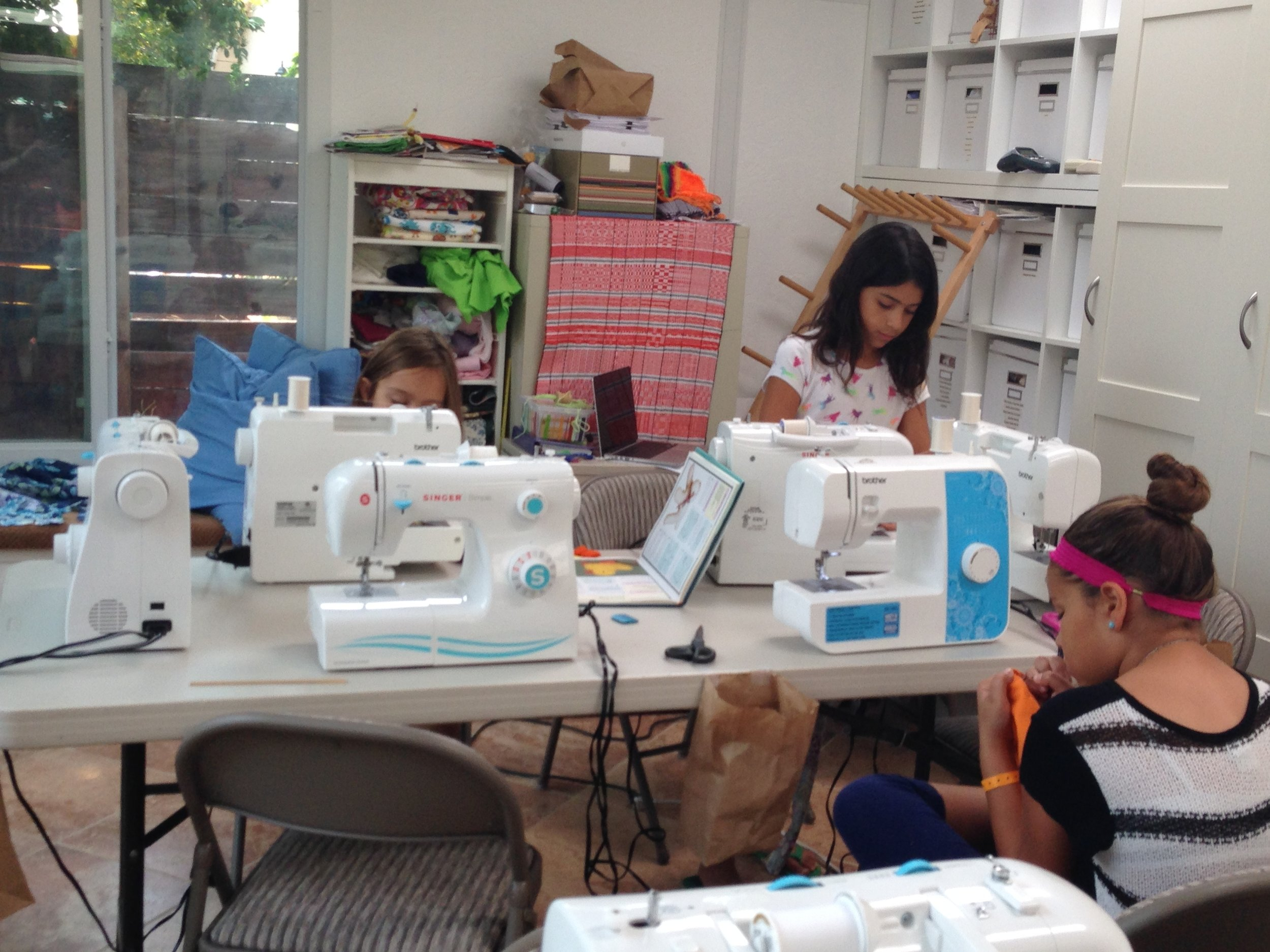 Sewing on machines.
