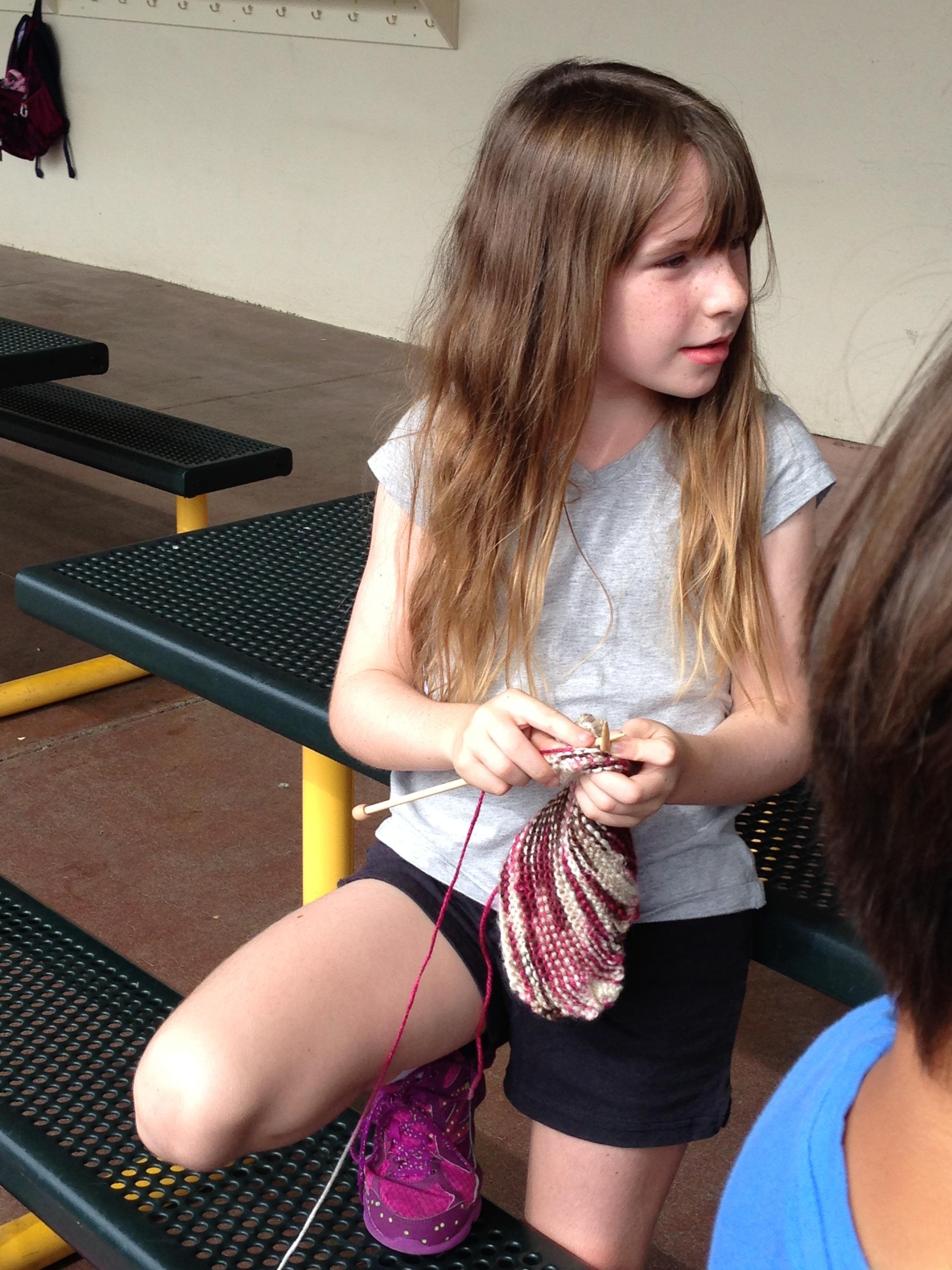 3rd grader finishing up a slipper.