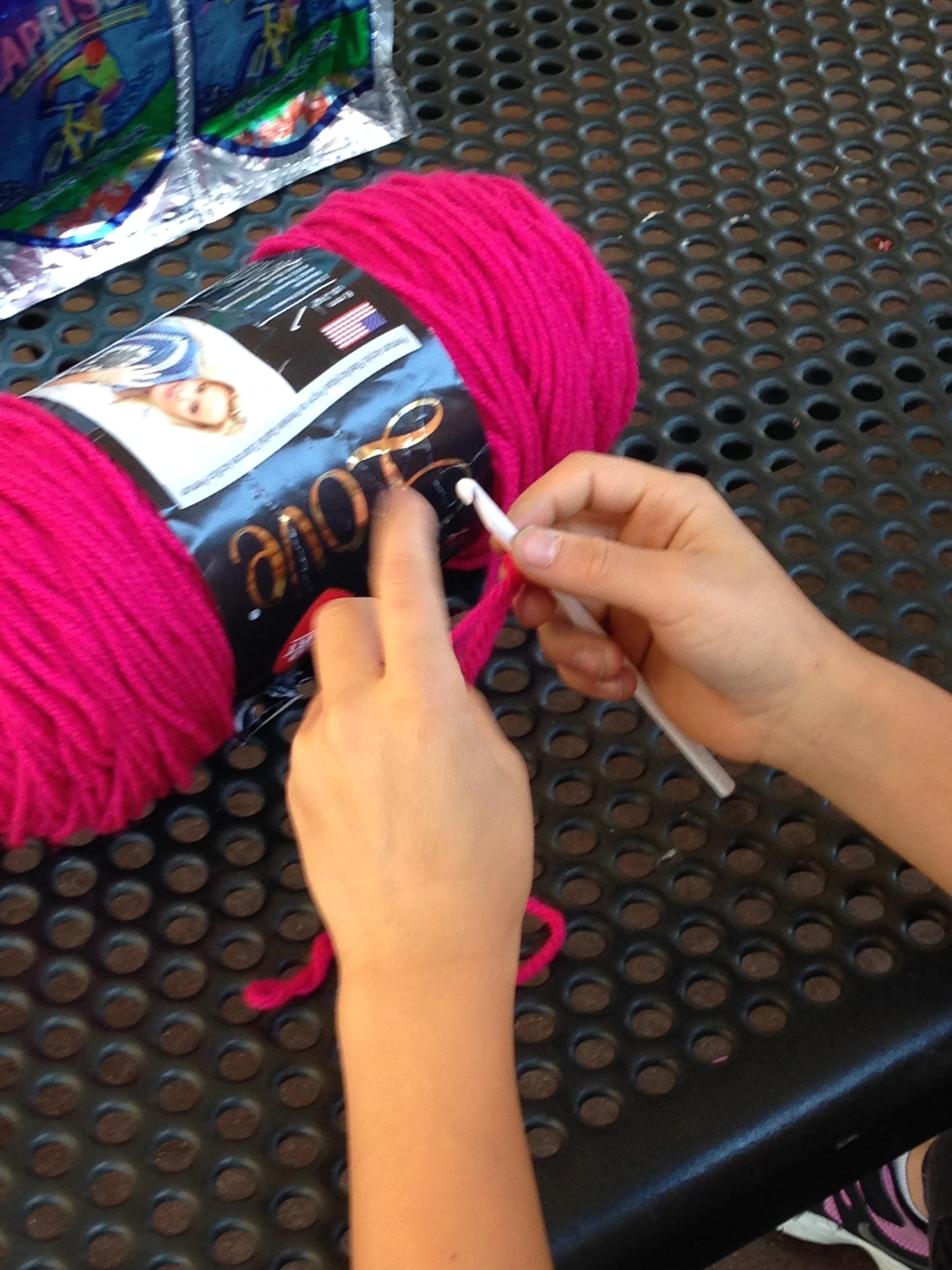 3rd grader learning to crochet.