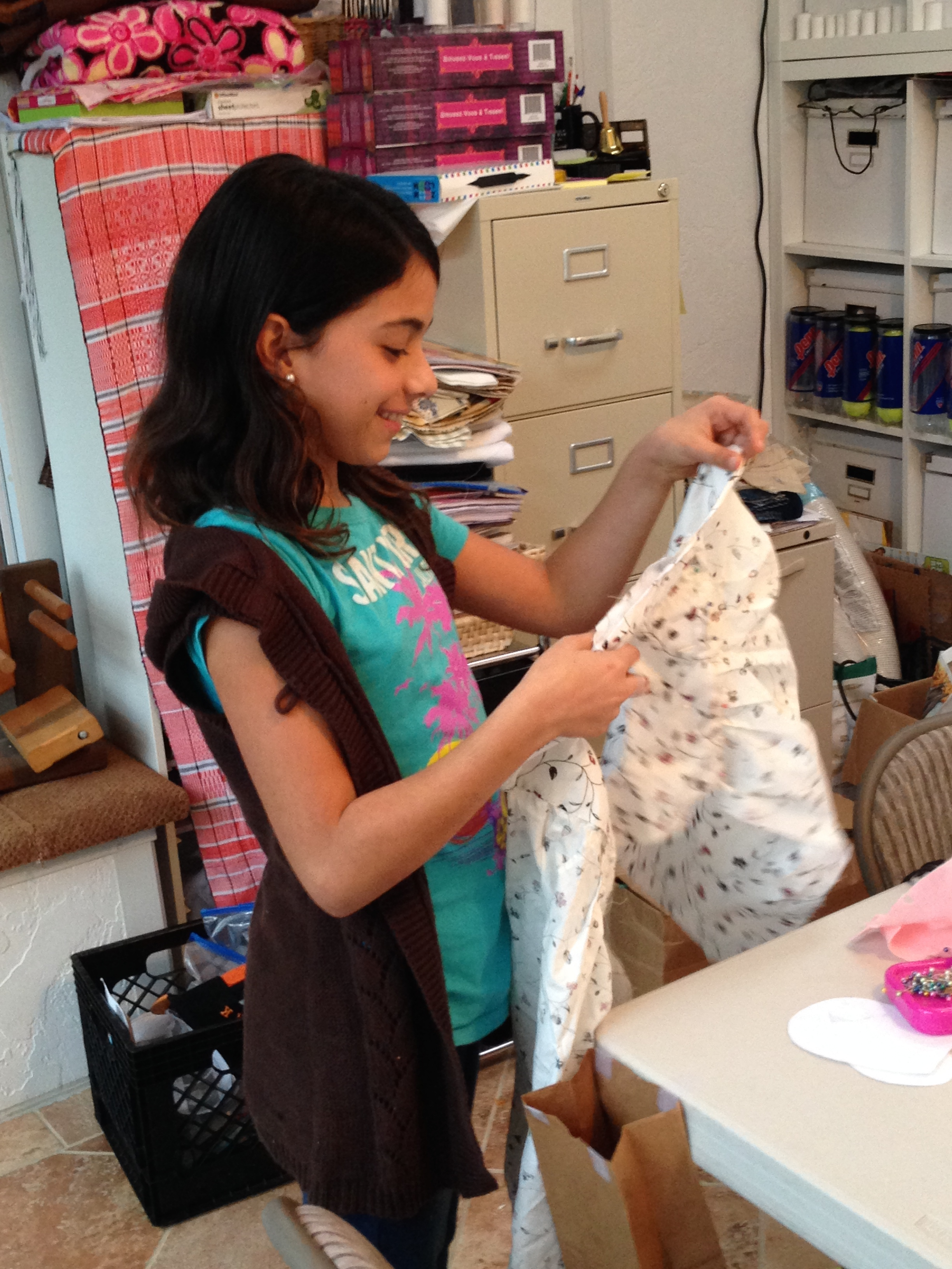 4th grader working on her shirt.