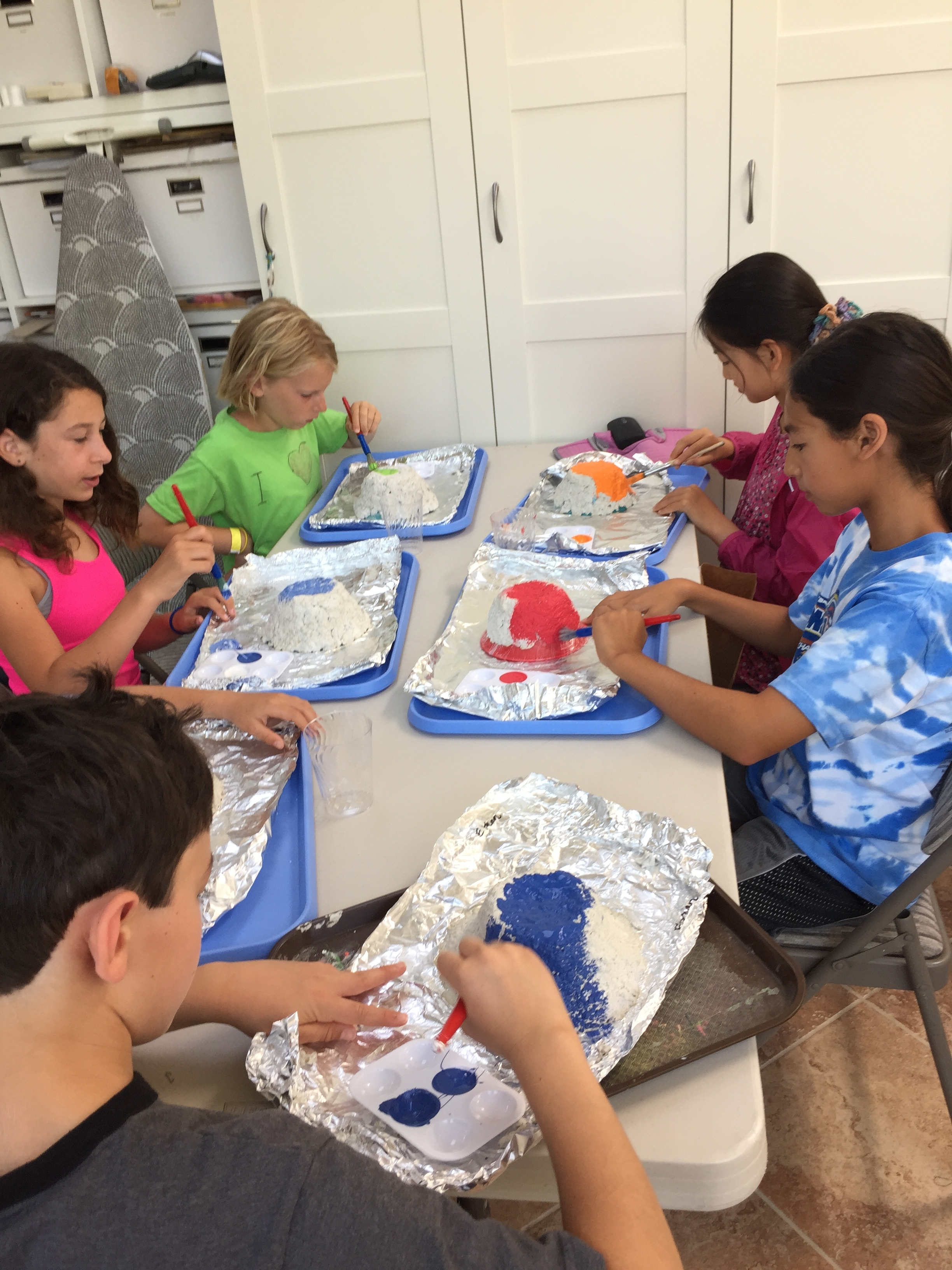 Painting paper pulp bowls.