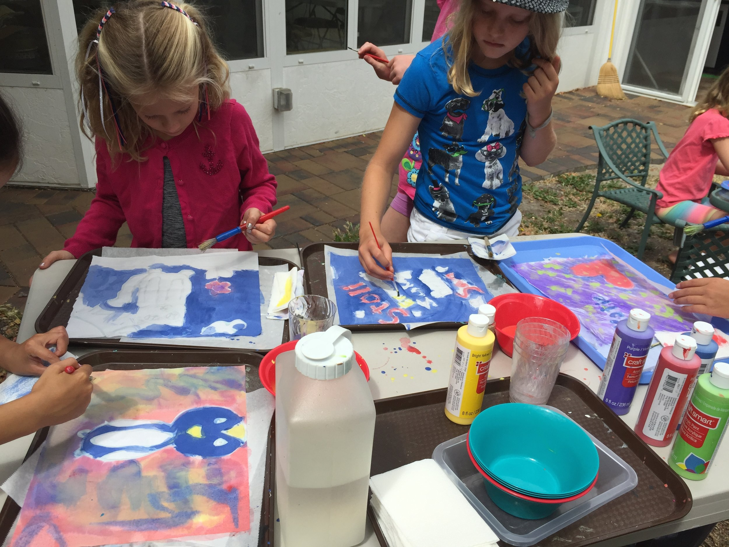 Painting our glue batik projects.