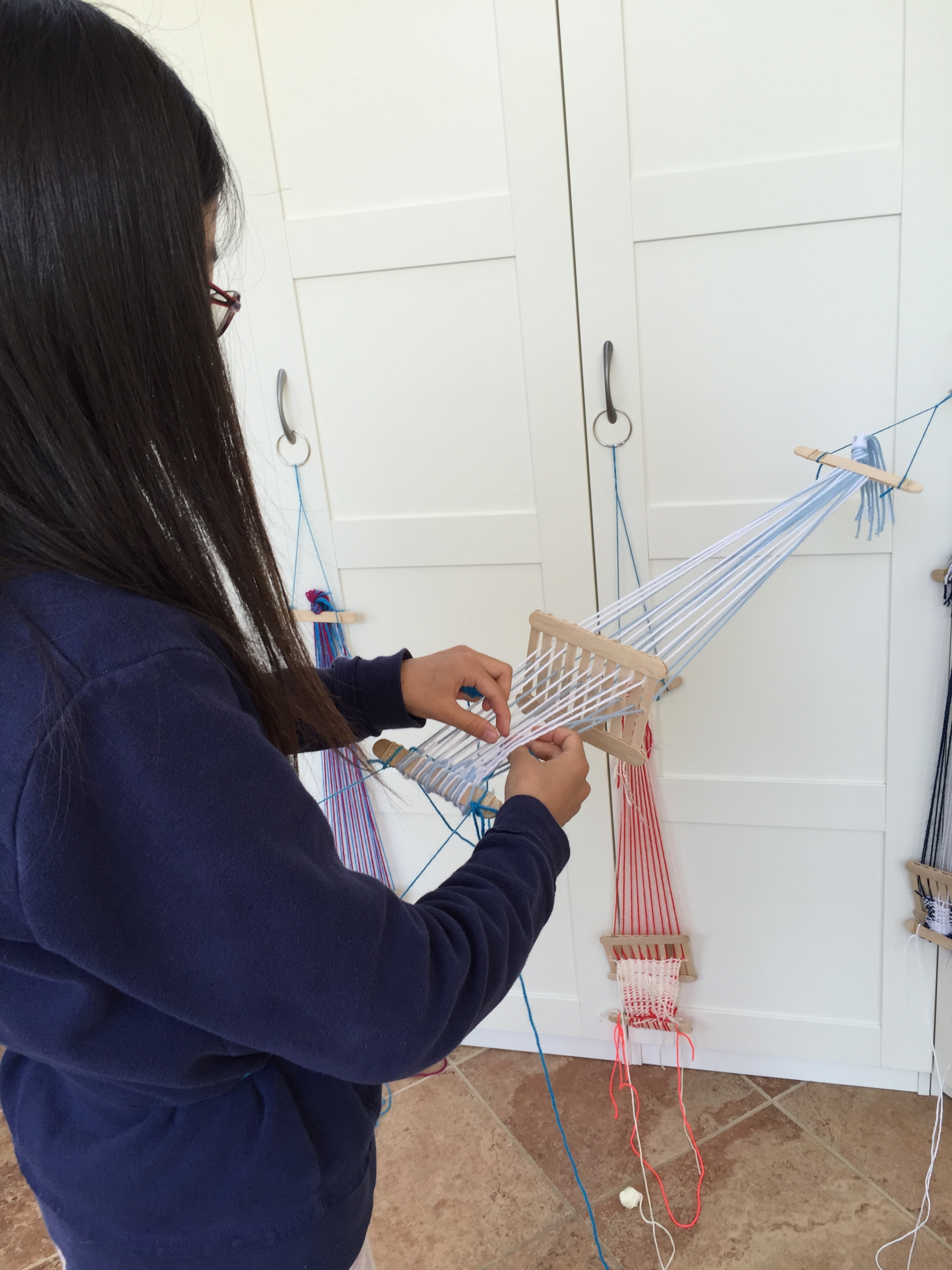 Using a back strap loom.