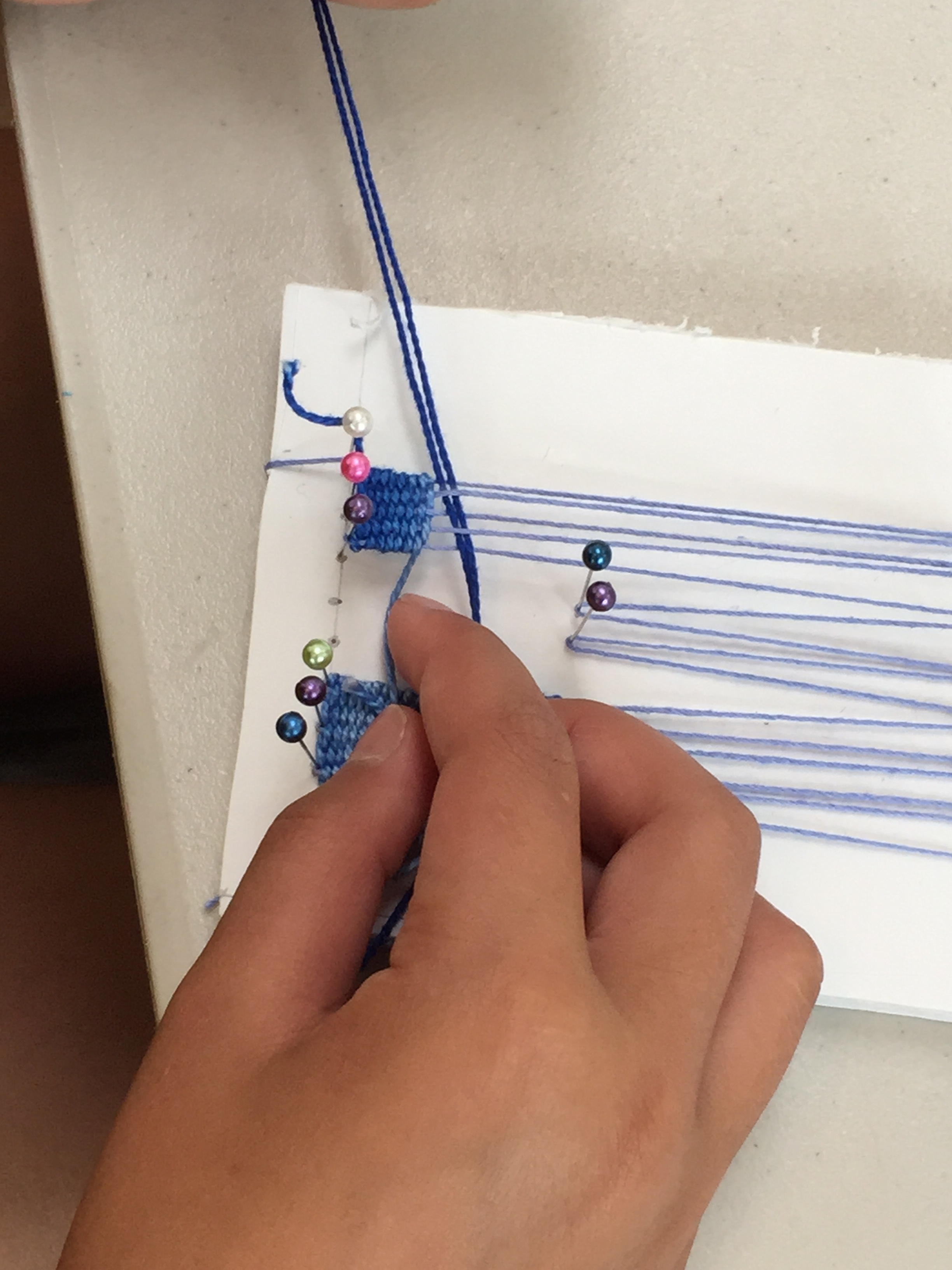 More pin weaving.