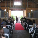 Wedding Ceremony with red carpet in barn at Brookleigh Estate