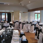 Wedding Reception with white chairs and black ribbons at Brookleigh Estate
