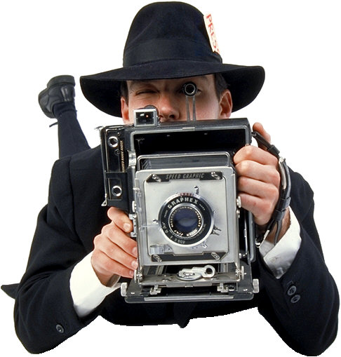 old fashioned camera being held by reporter on ground