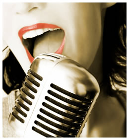 old fashioned radio microphone with woman singing into it
