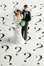 Bride and groom cake topper with question mark background