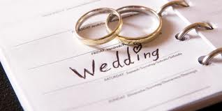 Wedding diary with golden wedding rings