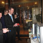 Men playing videogames on nintendo 64 and playstation at a wedding