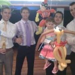 Men entertainers with ballon animals with children at a wedding