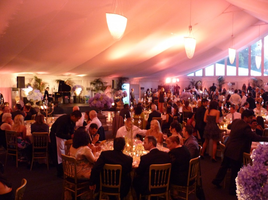 Guest sitting in a marquee organised by wedding planner