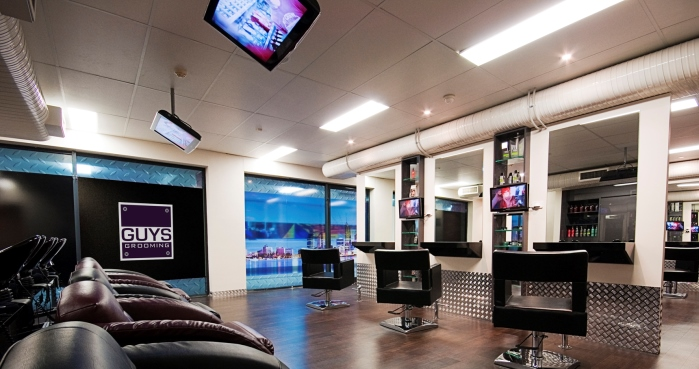 Hair studio at guys grooming with chairs and tvs