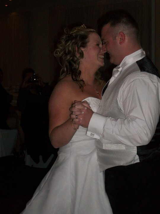 Bride and Groom smiling as they do a bridal waltz