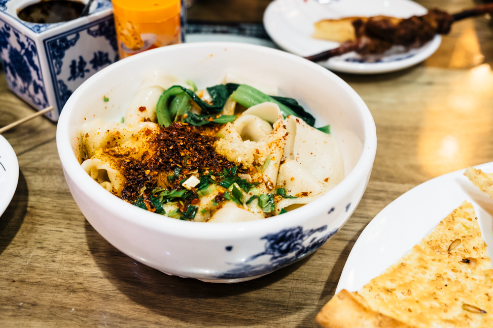 Biang Biang Noodles Muslim AMAZING FOODS YOU HAVE TO TRY WHEN VISITING MUSLIM STREET IN XI'AN CHINA| Visit Muslim Street Xian | visiting muslim street Xi'an China| Muslim Quarter in Xi'an | Muslim Street Market Xi'an China | Xi'an China Muslim Quarter | #Xi'an #China #traveltip # | Xian Muslim Street food | tips for visiting Muslim Street in Xi'an China | #MuslimStreet #xian #China
