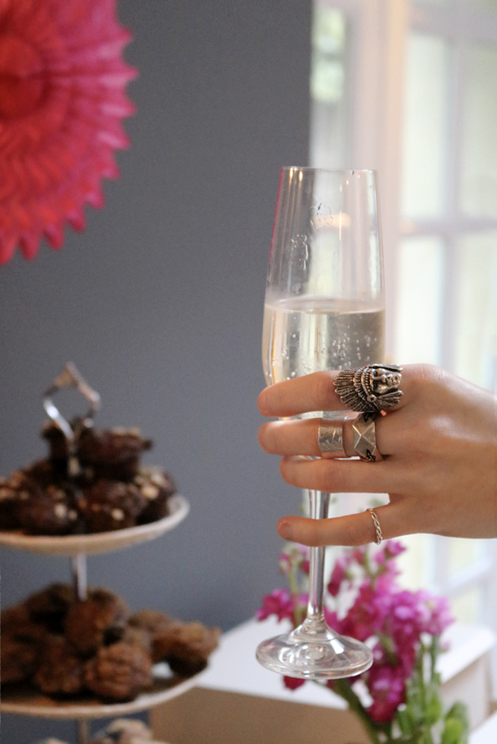 Champagne glass at 21st birthday part with silver rings