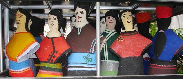 Paper mache dolls crowded into a bus