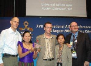 Indoor group photo of APNSW members receiving award