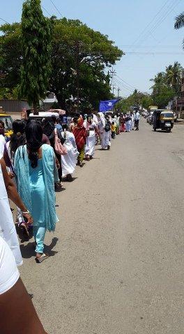 members of VAMP march down a sunlit street