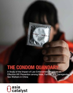 a sex worker holds a wrapped condom up to the camera concealing her face