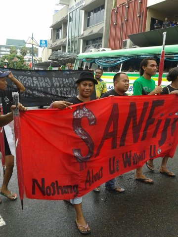 """Demonstrators carry banner saying """"SAN Fiji - nothing about us without us"""""""