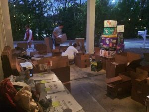 Our carport Friday night, where neighbors, family and friends showed up to help.