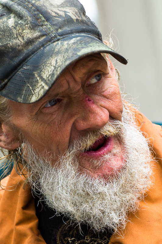 """Singing """"I Want To Hold Your Hand"""" on streets of Denver. Homeless? Maybe, maybe not."""