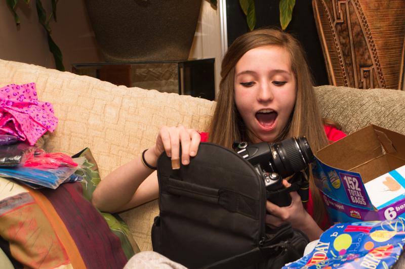 Kelsey opening her new Nikon DSLR on her birthday