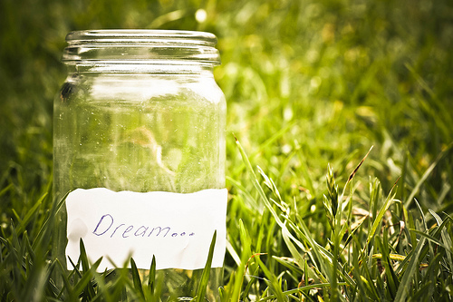 dream jar in a field of grass