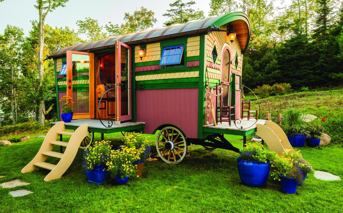 A gypsy caravan is my idea of a perfect tiny house. This one is called Bohemian Princess. :-)