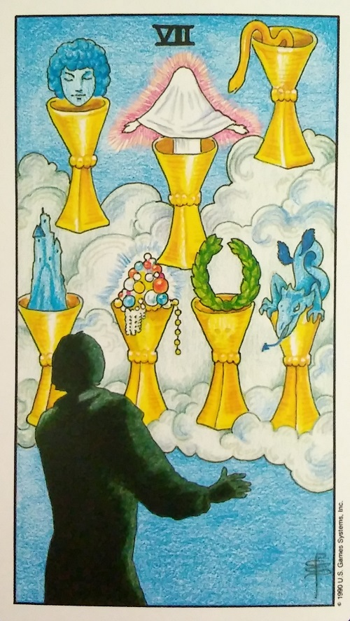 Seven of Cups ~ Universal Waite Tarot, created by Stuart P. Kaplan, drawings by Pamela Colman Smith, recolored by Mary Hanson-Roberts, published by U.S. Games Systems, Inc.