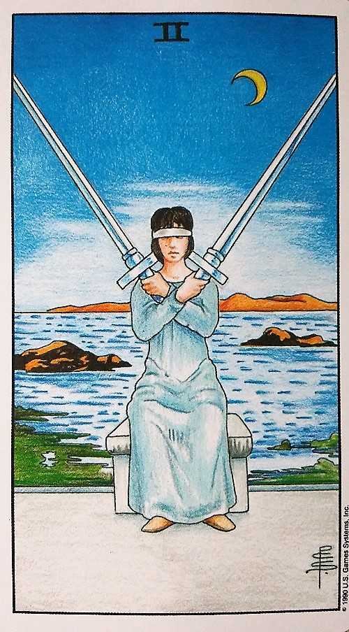 Two of Swords ~ Universal Waite Tarot deck, created by Stuart P. Kaplan, artwork by Pamela Colman Smith, recoloring by Mary Hanson-Roberts, published by U.S. Games Systems, Inc.