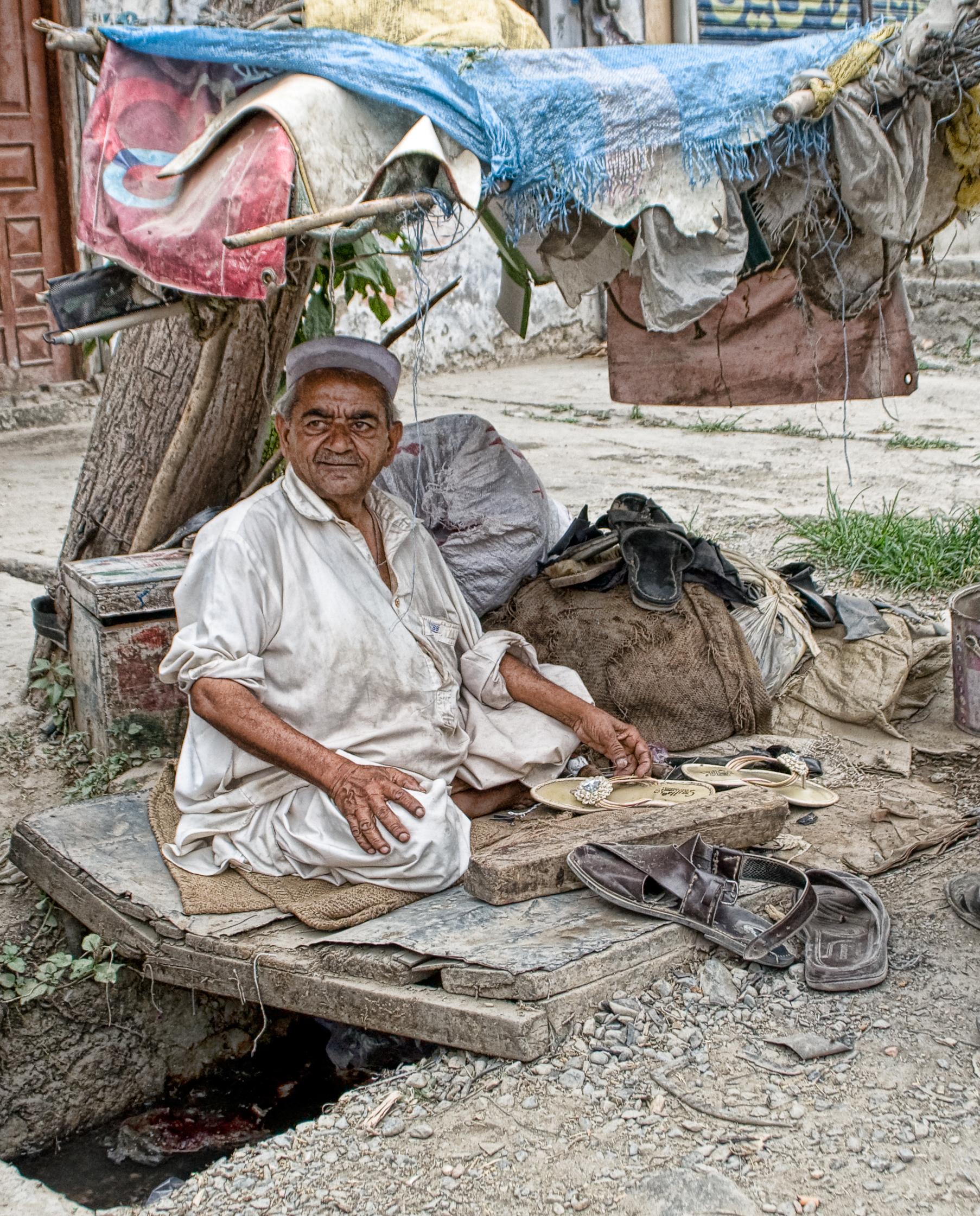 A street cobbler called Roshan Deen from Haripur