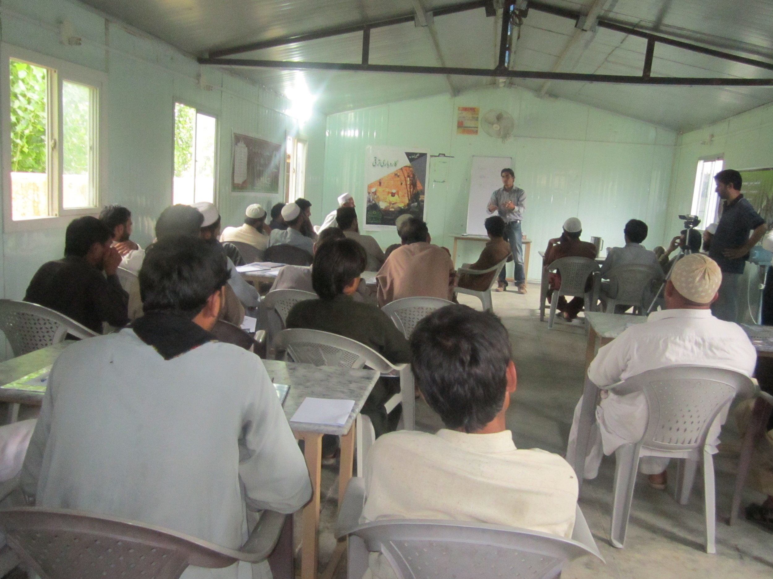 Nazish Zahoor taking the day 1 class for the mini-MBA program for street cobblers
