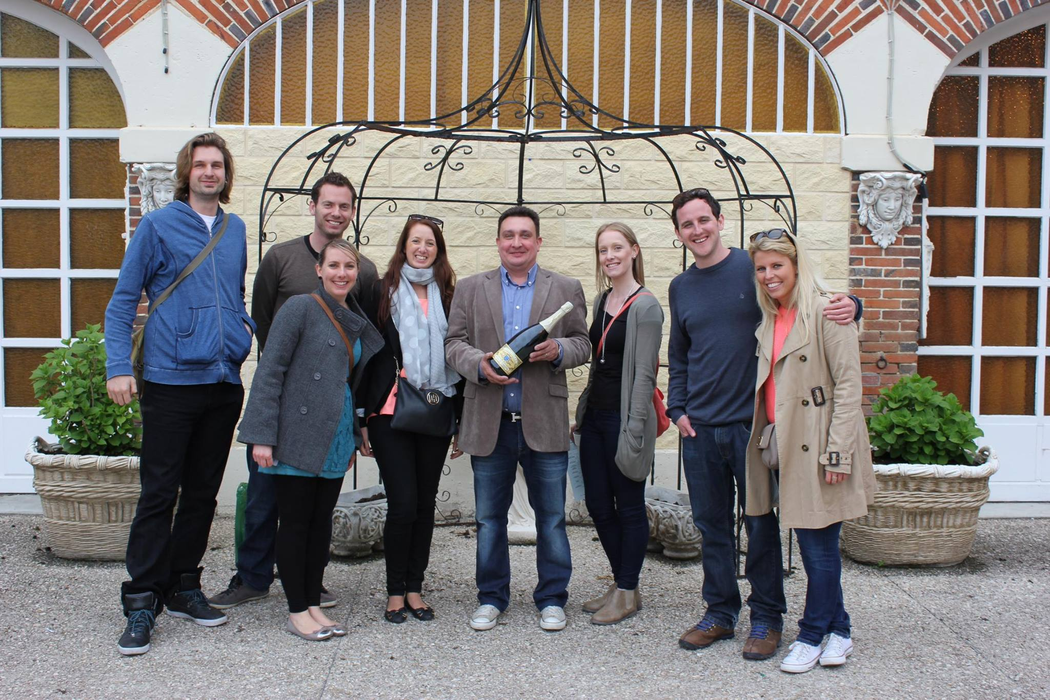 The crew with owner Pascal and our magnum. Photo by Tamara Heckle.