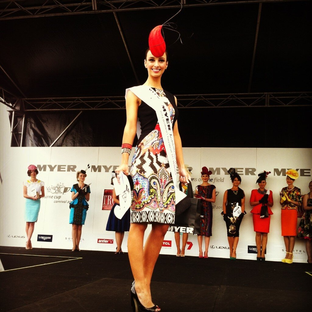Tasmanian winner Alex Hecker in an Etro dress and a Rebecca Share Millinery headpiece. Photo from VRC.