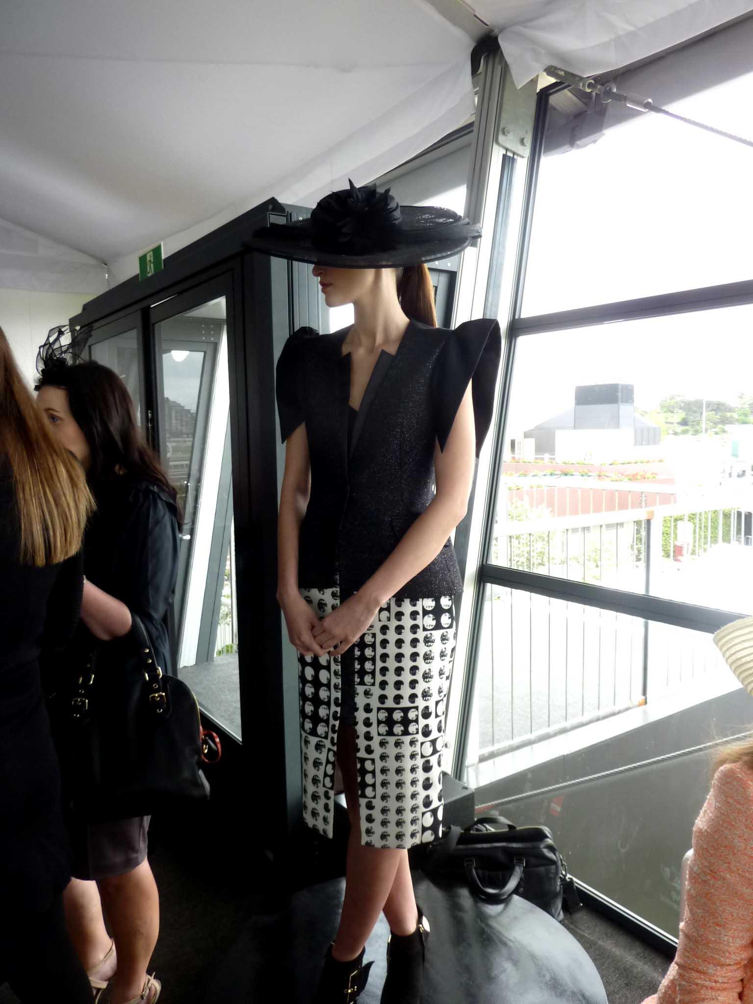 A model wears racewear fit for Derby Day from Myer.