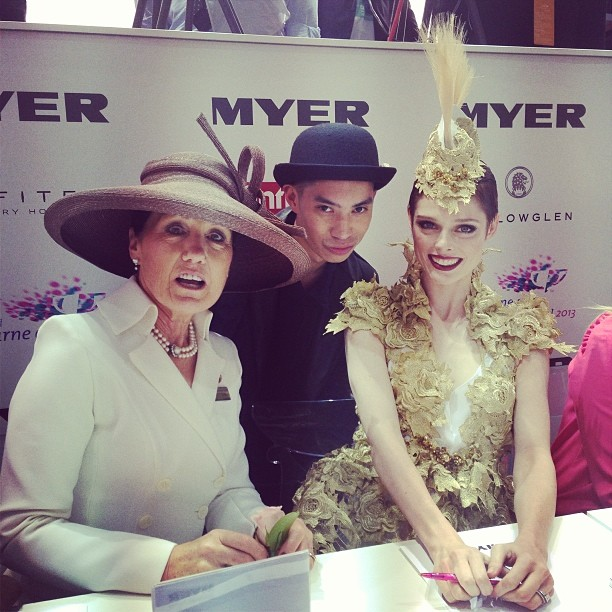 Coco Rocha (right) poses for a quick pic with the designer of her outfit, Anthony Capon (centre), while VRC Vice Chairman Amanda Eliiot is caught unaware. Photo from www.instagram.com/anthonycapon.