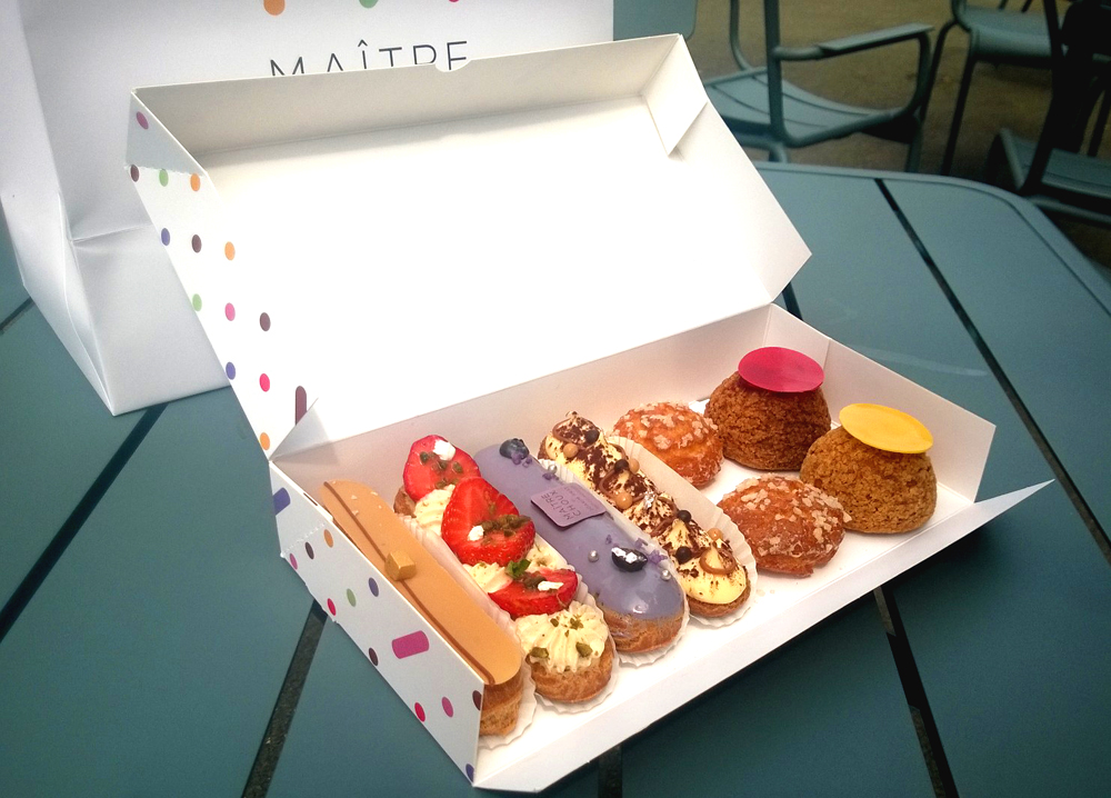 Sweet treats from Maître Choux, from L-R: salted caramel, Tahitian vanilla and strawberry, violet and berry, tiramisu; unfilled chouquettes; raspberry and Sicilian lemon choux buns
