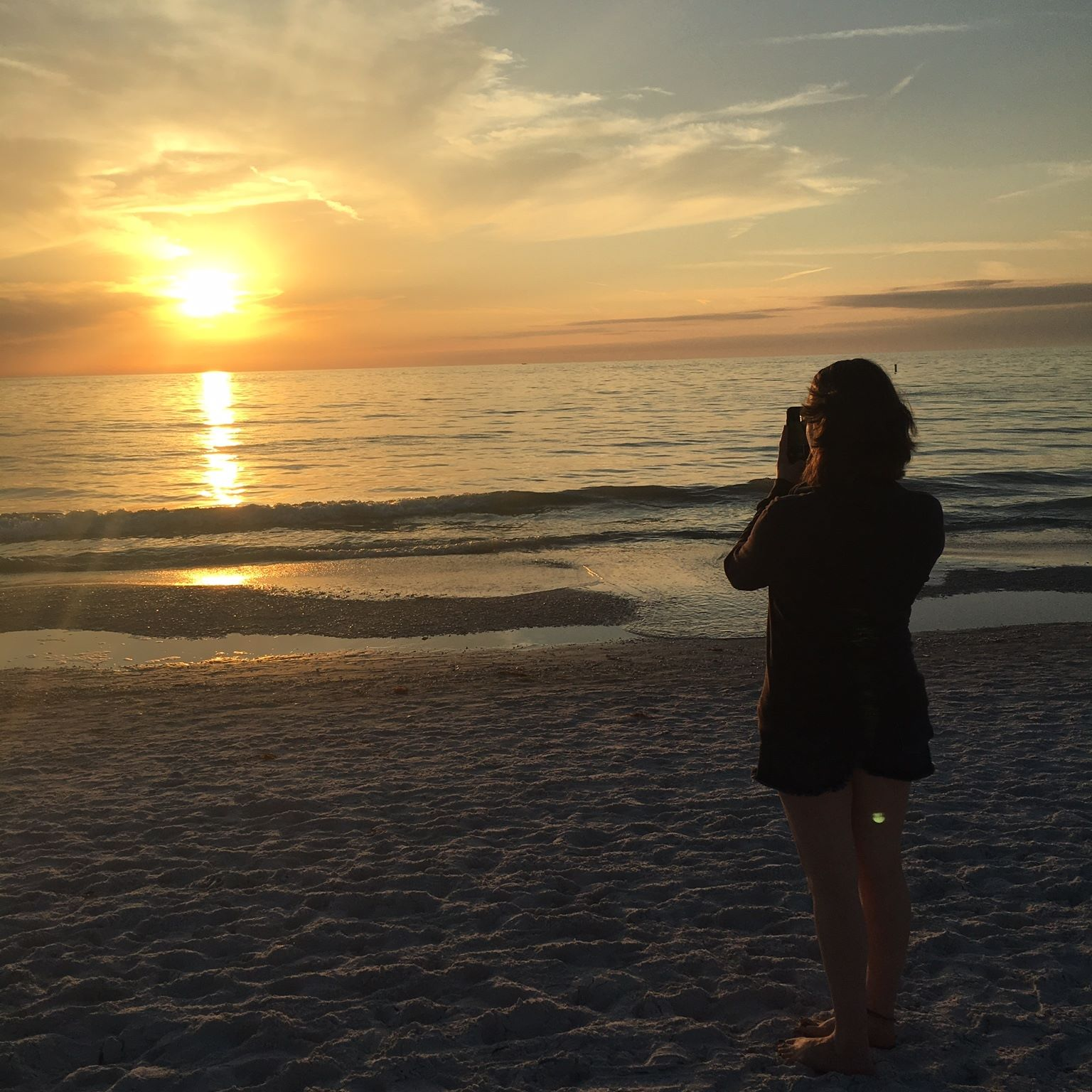 Beach Sunset Taking Picture in Florida