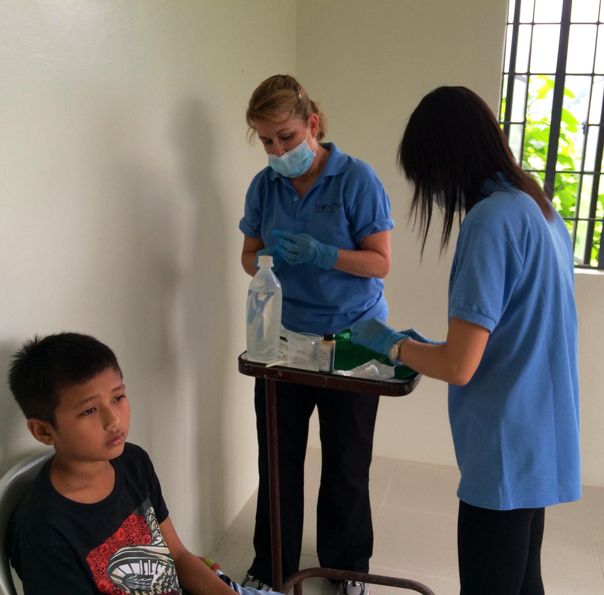 Vicki Brett Providing Dental Care