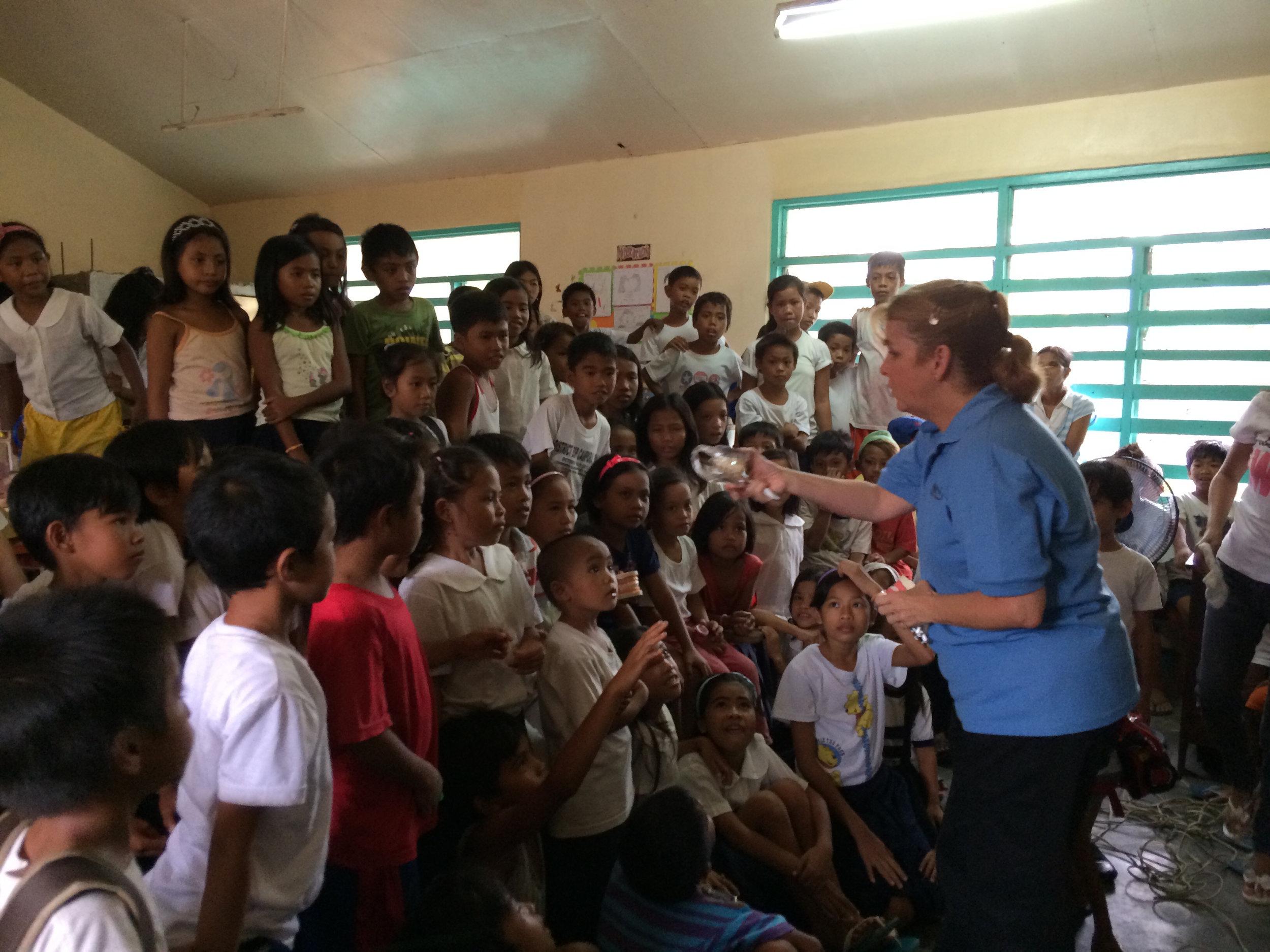 Vicki Brett addressing students at an elementary school