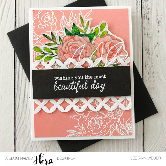 Using the bouquest as a simple background in white embossing makes pulls the bouquet together on the panel.